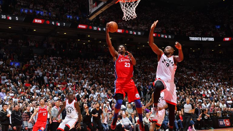 Jimmy Butler f the Philadelphia 76ers shoots a lay up to tie the game late in the fourth quarter against the Toronto Raptors during Game Seven of the Eastern Conference Semi-Finals of the 2019 NBA Playoffs