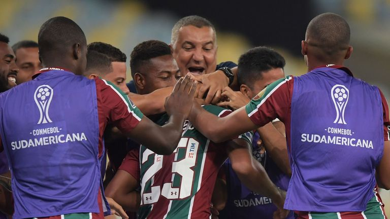Joao Pedro is mobbed by his team-mates after scoring a hat-trick for Fluminense against Atletico Nacional
