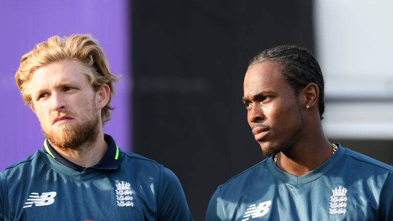Jofra Archer of England and David Willey of England look on during the 5th One Day International between England and Pakistan at Headingley on May 19, 2019 in Leeds, England.
