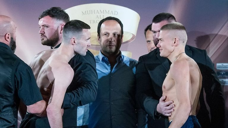 Josh Taylor and Ivan Baranchyk are held apart after their intense face-off