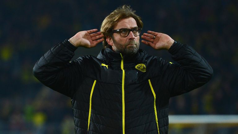 Jurgen Klopp, Coach of Borussia Dortmund gestures to fans after the UEFA Champions League Quarter Final second leg match between Borussia Dortmund and Real Madrid at Signal Iduna Park on April 8, 2014 in Dortmund, Germany.