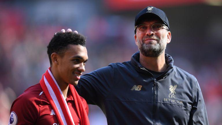 Jurgen Klopp embraces Trent Alexander-Arnold after Liverpool narrowly miss out on the Premier League title