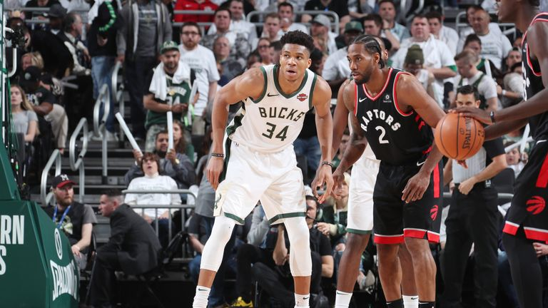 Giannis Antetokounmpo #34 of the Milwaukee Bucks and Kawhi Leonard #2 of the Toronto Raptors defend their positions during Game One of the Eastern Conference Finals of the 2019 NBA Playoffs on May 15, 2019 at the Fiserv Forum Center in Milwaukee, Wisconsin