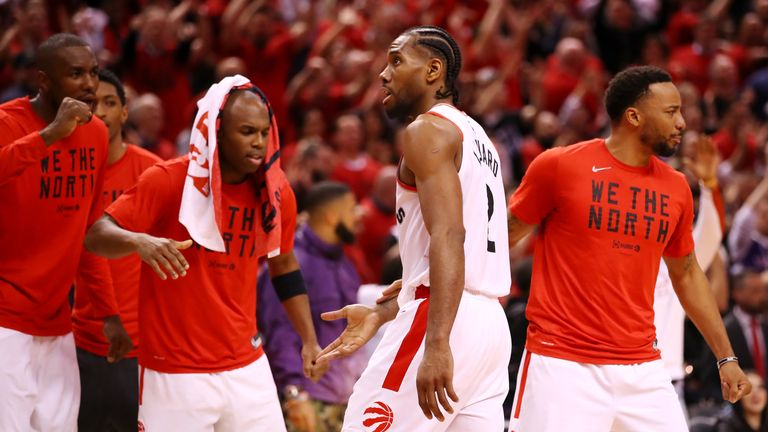 Kawhi Leonard of the Toronto Raptors celebrates with teammates on the bench during overtime against the Milwaukee Bucks in game three of the NBA Eastern Conference Finals