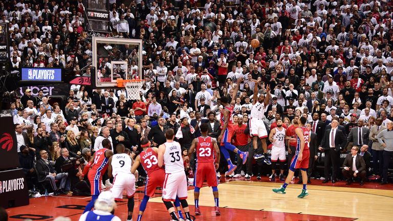 Kawhi Leonard of the Toronto Raptors shoots the game winning basket against the Philadelphia 76ers during Game Seven of the Eastern Conference Semi-Finals of the 2019 NBA Playoffs