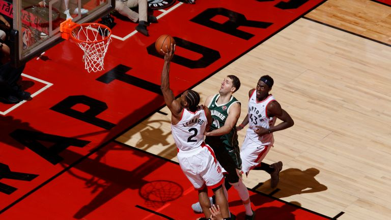Kawhi Leonard of the Toronto Raptors dunks against the Milwaukee Bucks during Game Three of the Eastern Conference Finals