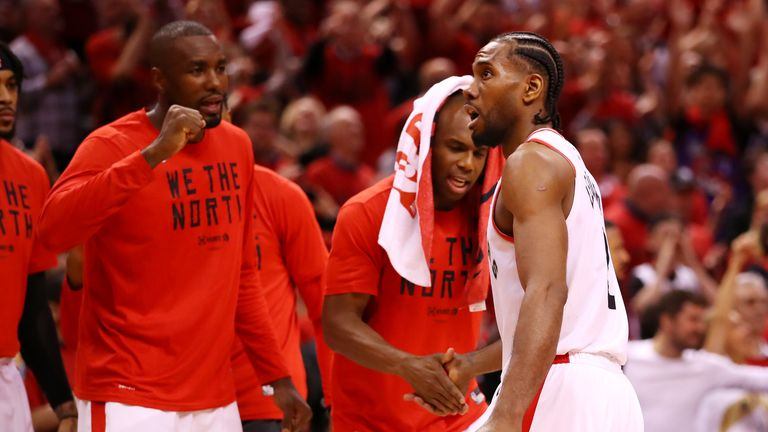 Kawhi Leonard #2 of the Toronto Raptors celebrates with teammates on the bench during overtime against the Milwaukee Bucks in game three of the NBA Eastern Conference Finals at Scotiabank Arena on May 19, 2019 in Toronto, Canada.