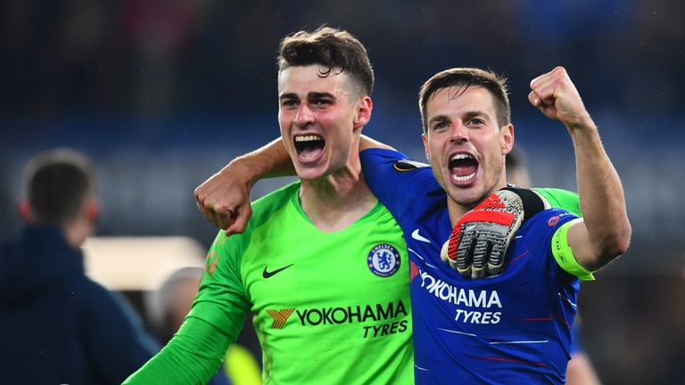 Kepa Arrizabalaga and Cesar Azpilicueta (right) hope to be celebrating some silverware in Baku at the end of the month