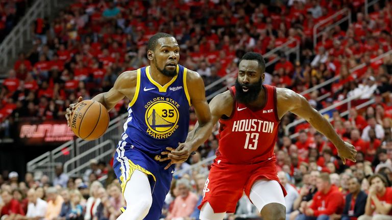 Kevin Durant #35 of the Golden State Warriors drives to the basket defended by James Harden #13 of the Houston Rockets in the fourth quarter during Game Three of the Second Round of the 2019 NBA Western Conference Playoffs at Toyota Center on May 4, 2019 in Houston, Texas