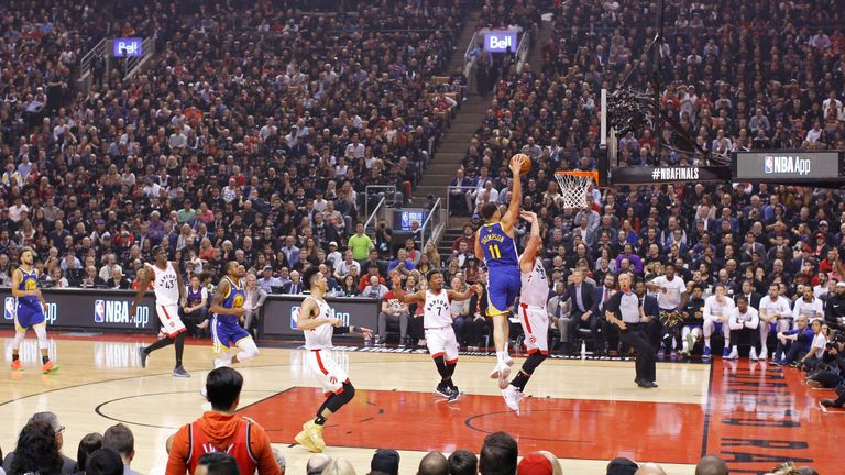 Klay Thompson of the Golden State Warriors dunks the ball against the Toronto Raptors during Game One of the NBA Finals