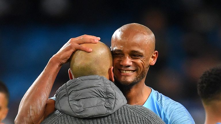 Kompany embraces manager Pep Guardiola following his crucial goal against Leicester earlier in May