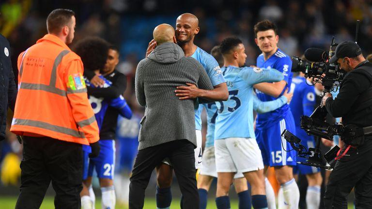 Vincent Kompany celebrates with Pep Guardiola