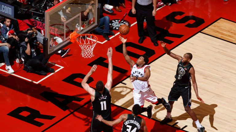 Kyle Lowry of the Toronto Raptors goes to the basket against the Milwaukee Bucks during Game Six of the Eastern Conference Finals