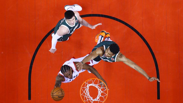 Kawhi Leonard of the Toronto Raptors shoots the ball against Giannis Antetokounmpo of the Milwaukee Bucks during the first half in game three of the NBA Eastern Conference Finals