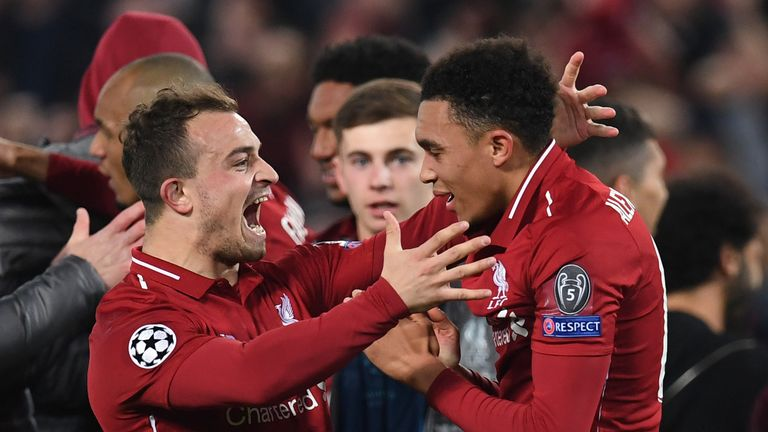 Trent Alexander-Arnold and Xherdan Shaqiri celebrate after Liverpool beat Barcelona 4-0 in the Champions League.