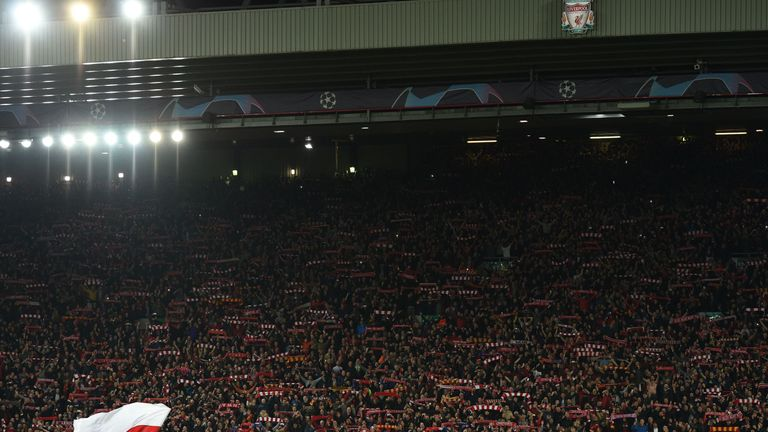 Liverpool players and staff line up in front of the Kop at the full time