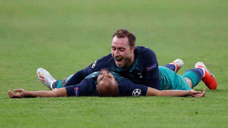 Tottenham's Brazilian forward Lucas celebrates after scoring a goal with teammate Tottenham's Danish midfielder Christian Eriksen (up) during the UEFA Champions League semi-final second leg football match between Ajax Amsterdam and Tottenham Hotspur at the Johan Cruyff Arena, in Amsterdam, on May 8, 2019. (Photo by Adrian DENNIS / AFP) (Photo credit should read ADRIAN DENNIS/AFP/Getty Images)