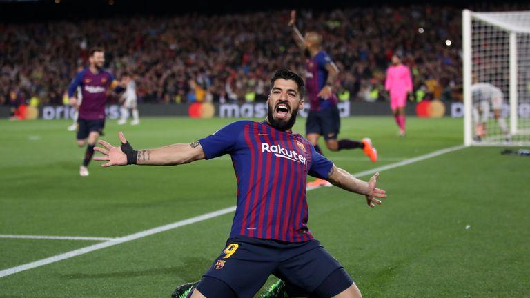 Barcelona's Luis Suarez celebrates scoring against Liverpool