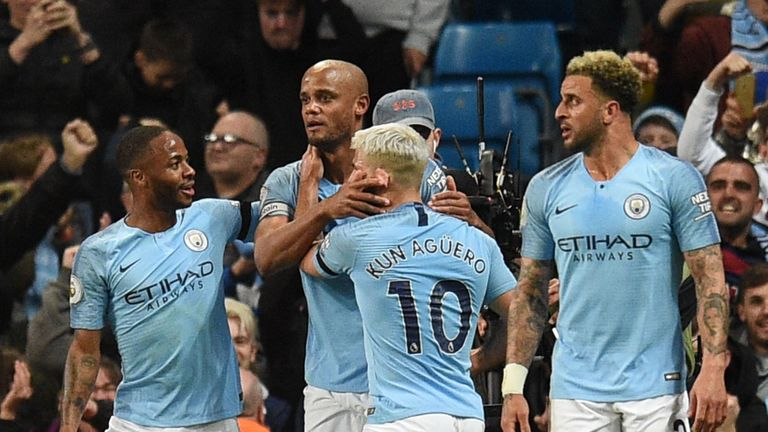 Manchester City captain Vincent Kompany (c) is out of contract in the summer