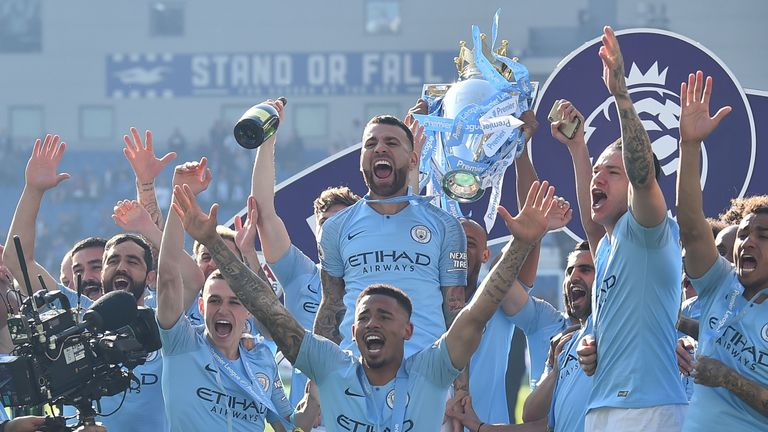Manchester City players celebrate after winning the Premier League title