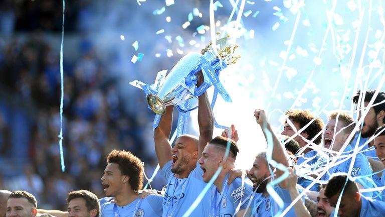 Manchester City captain Vincent Kompany lifts the Premier League trophy