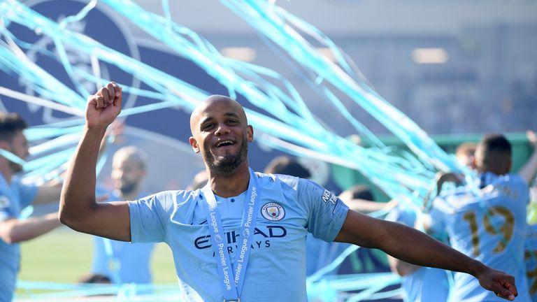 Manchester City's Vincent Kompany celebrates winning the Premier League title