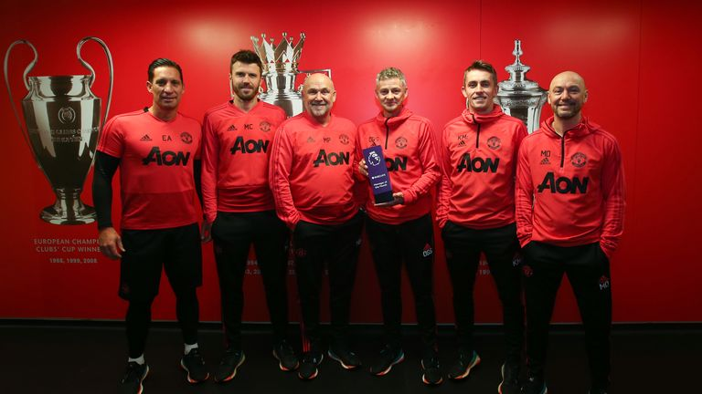 Ole Gunnar Solskjaer and coaching staff with the Barclays manager of the month award for February 2019