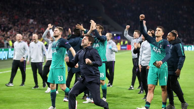 Pochettino (centre) celebrates with his team at the final whistle