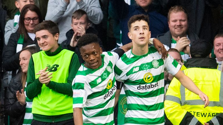 Celtic's Mikey Johnston (right) celebrates his second goal with Karamoko Dembele