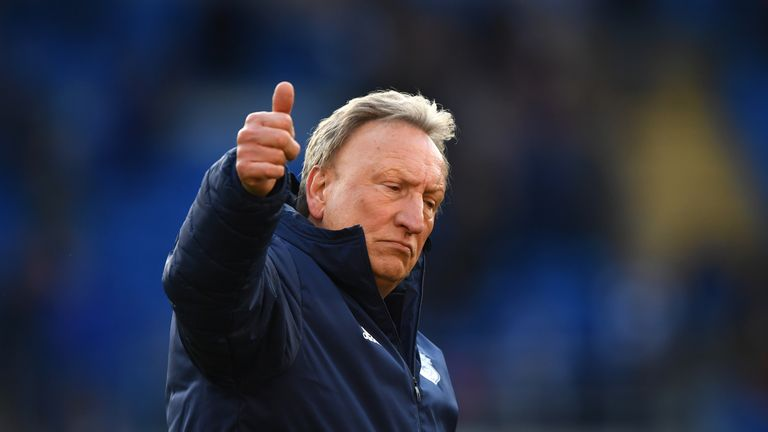 Neil Warnock gestures to Cardiff fans after their home defeat to Crystal Palace