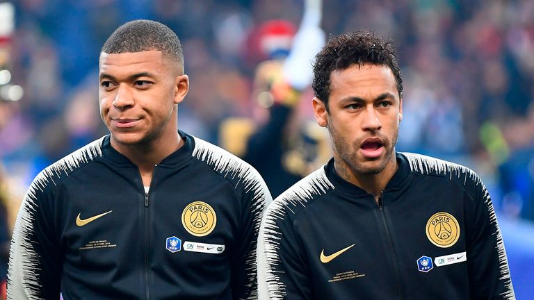 Paris Saint-Germain's French forward Kylian Mbappe (L) and Brazilian forward Neymar react as stand prior to the start of the French Cup final football match between Rennes (SRFC) and Paris Saint-Germain (PSG), on April 27, 2019 at the Stade de France in Saint-Denis, outside Paris.