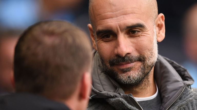Brendan Rodgers is greeted by Pep Guardiola prior to kick-off at the Etihad Stadium