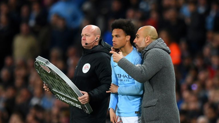 Pep Guardiola talks to substitute Leroy Sane during the Premier League match vs Leicester City at the Etihad Stadium