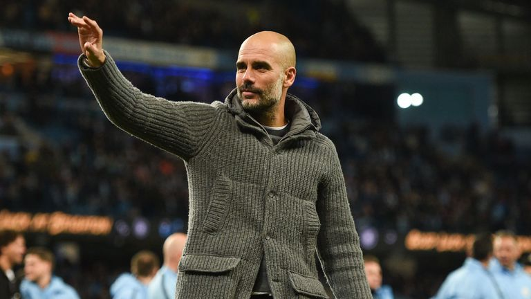 Pep Guardiola waves during a lap of the pitch following Manchester City's 1-0 win over Leicester City at the Etihad Stadium