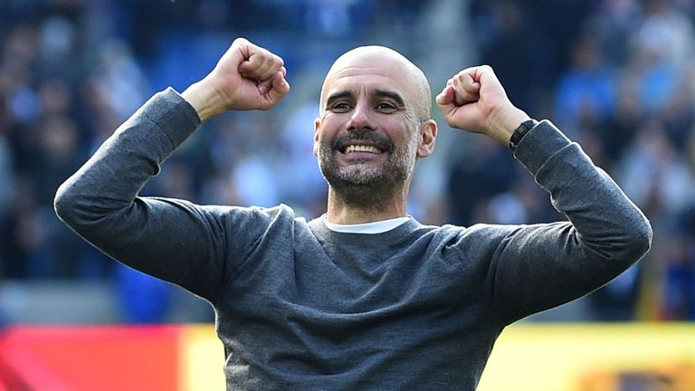 Pep Guardiola celebrates winning the Premier League title after the 4-1 win over Brighton