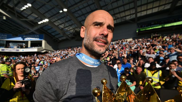 Pep Guardiola with the Premier League trophy at the AMEX Stadium