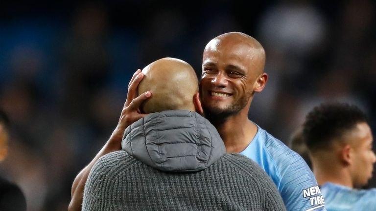 Pep Guardiola embraces Vincent Kompany after the 1-0 win over Leicester City