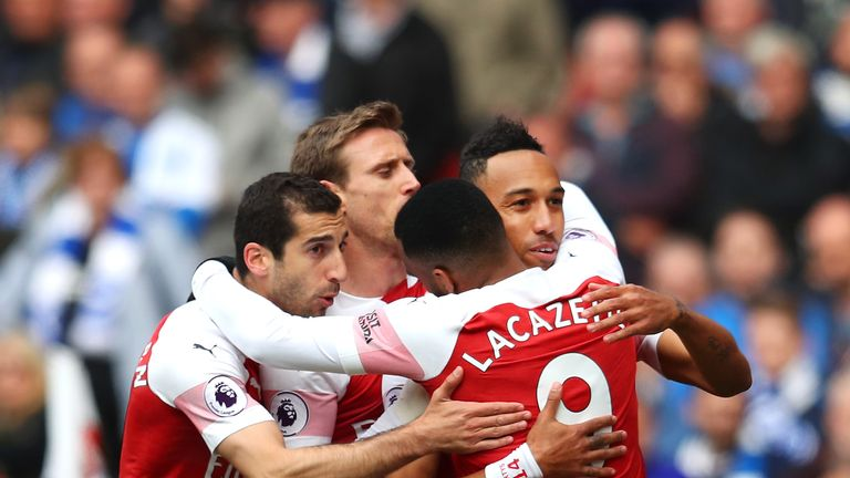 Pierre-Emerick Aubameyang celebrates with team-mates after giving Arsenal an early lead