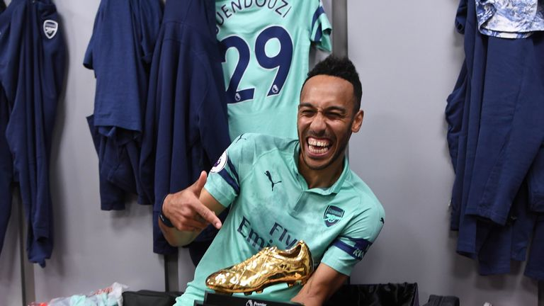 Pierre-Emerick Aubameyang poses with the Premier League golden boot award for the 2018/19 season