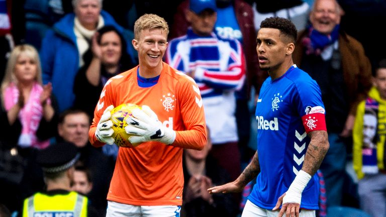 Ross McCrorie smiles with the ball in his hands after his cameo as a goalkeeper