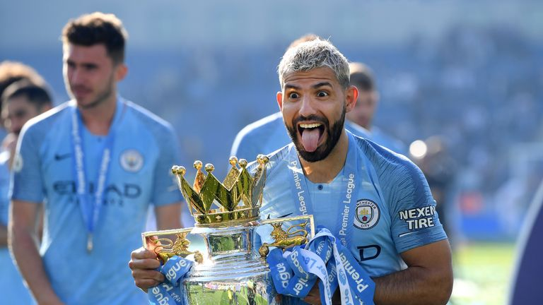 Sergio Aguero celebrates with the Premier League trophy after winning the title with a 4-1 victory over Brighton