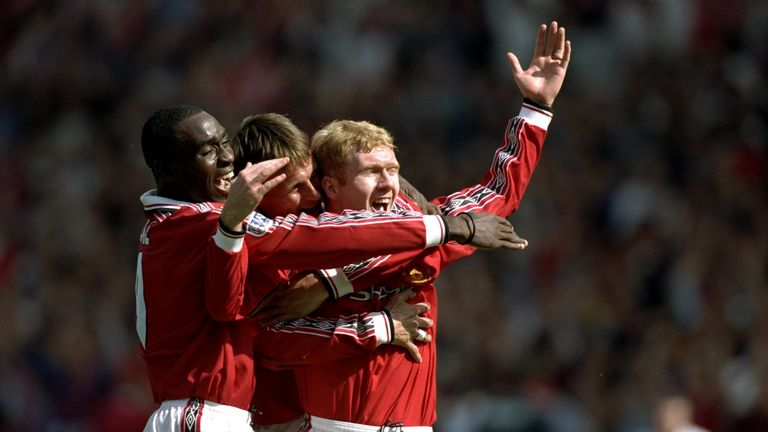 Andy Cole and Teddy Sheringham celebrate a goal during Manchester United's treble-winning 1998-99 season
