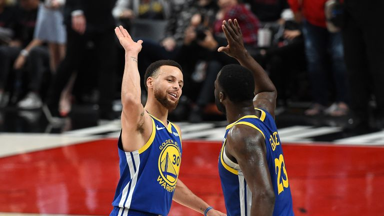 Stephen Curry #30 of the Golden State Warriors celebrates with Draymond Green #23 during the second half against the Portland Trail Blazers in game three of the NBA Western Conference Finals at Moda Center on May 18, 2019 in Portland, Oregon.