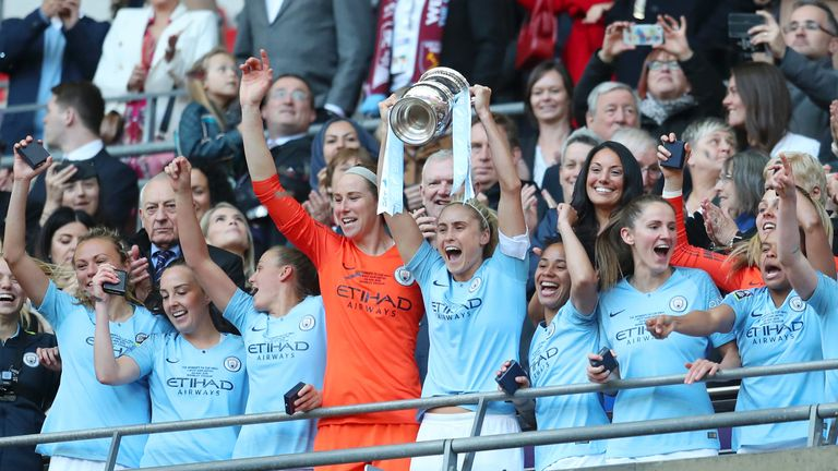 Steph Houghton of Manchester City Women lifts the Women's FA Cup Trophy