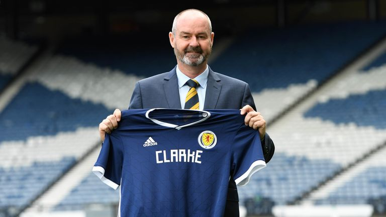 Steve Clarke pictured with Scotland shirt after being presented to the media