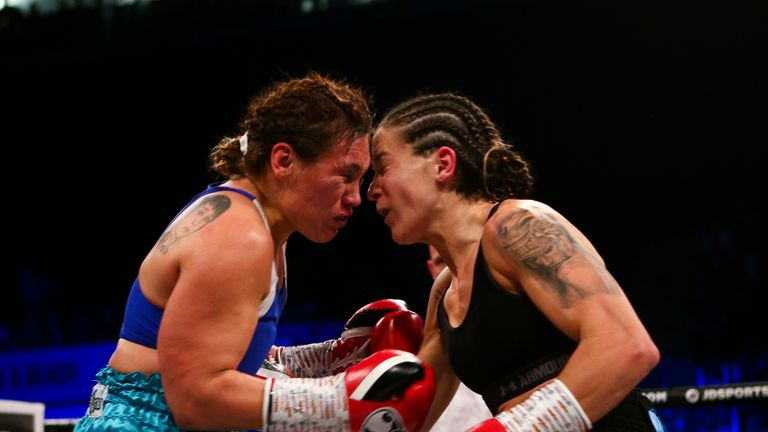 Harper and Lopez clash heads during the second round of their lightweight clash