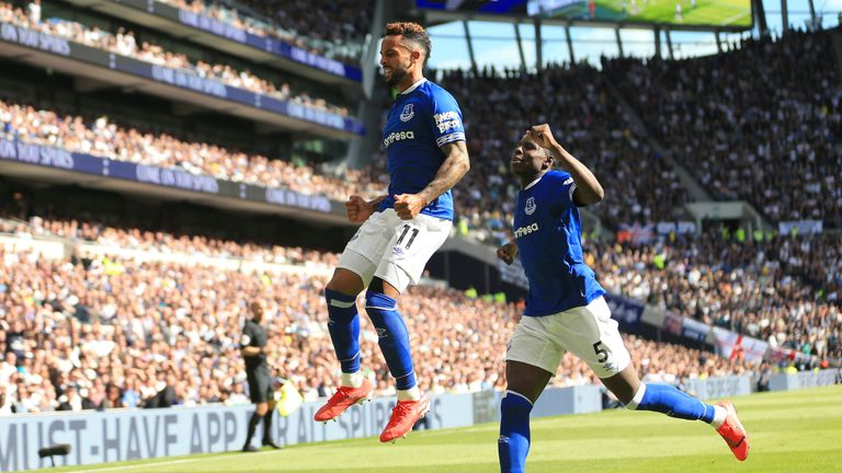 Theo Walcott celebrates hauling Everton level with a low finish after 69 minutes