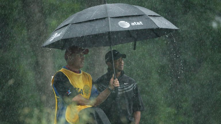 Woods shelters from the rain during the 2009 US Open