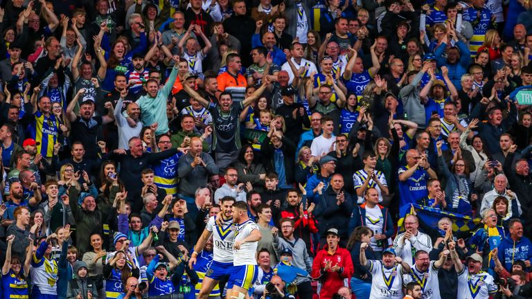 Toby King celebrates his try for Warrington with Tom Lineham.