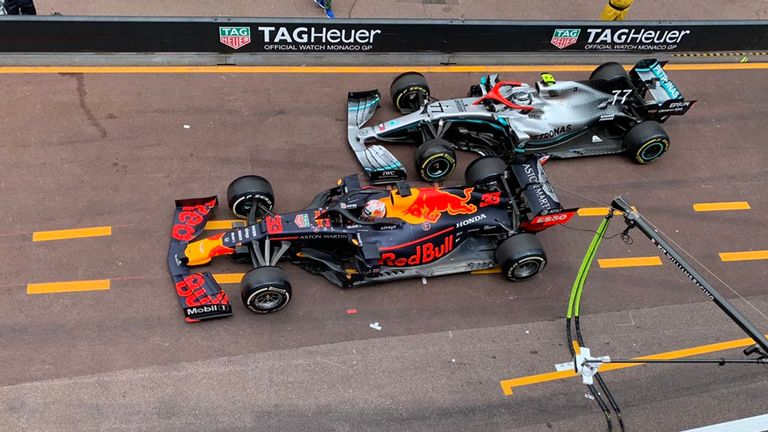 Max Verstappen and Valtteri Bottas touch in the pit-lane on exit during the Monaco Grand Prix